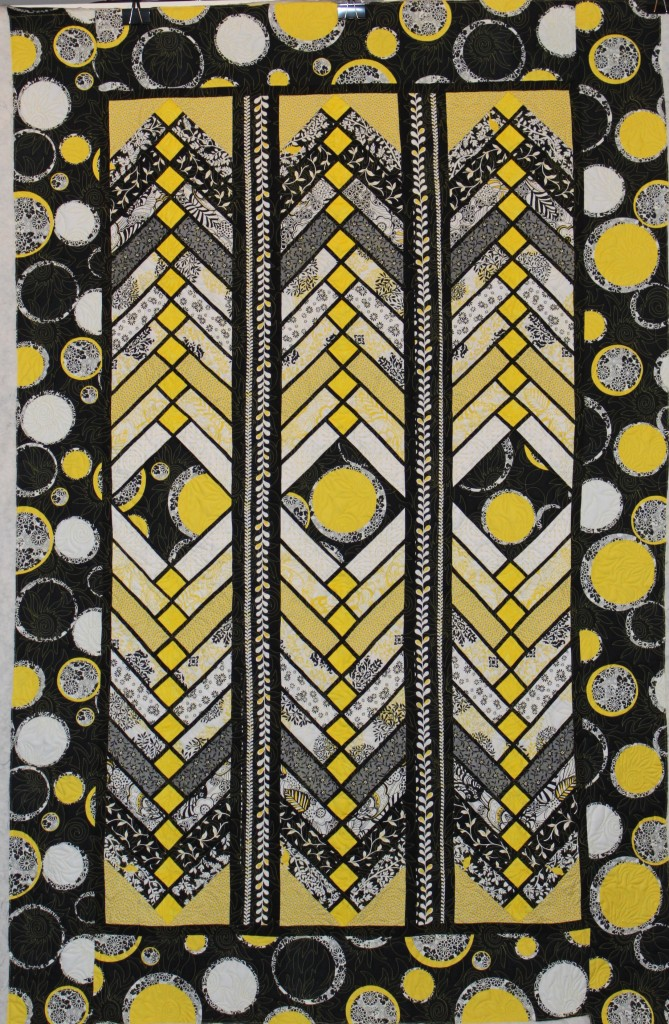 yellow and black french braid quilt
